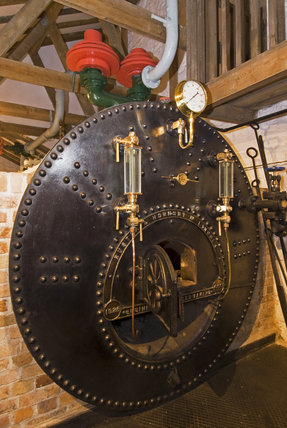 The boiler which heats the water to produce the steam which powers the beam engines at Cornish Mines & Engines at Pool, near Redruth, Cornwall