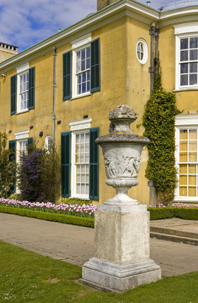 Ornamental urn, and part of the facade at Polesden Lacey, near Dorking, Surrey