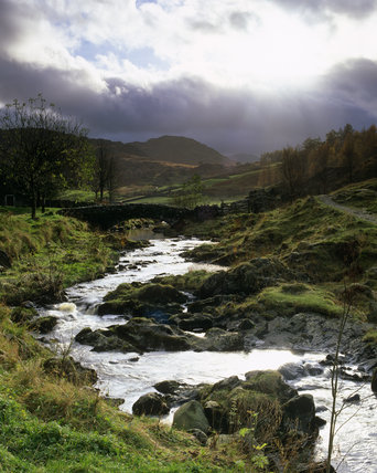 Rainclouds and a stream at Watendlath, on the east flanks of Borrowdale in the Lake District, Cumbria