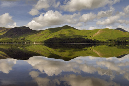 Catbells seen from the east shore of Derwentwater, with cloud reflections in the water, Cumbria
