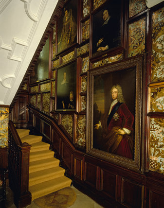 The north staircase,with Spanish leather hangings & portraits