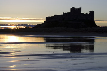 Sunrise silhouettes Bamburgh Castle (Not National Trust)