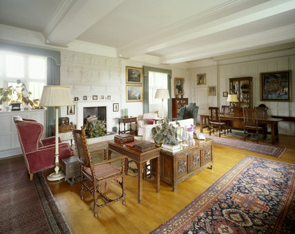 The Great Chamber or Library showing armchairs, sofa, fireplace & oak chest c 1700