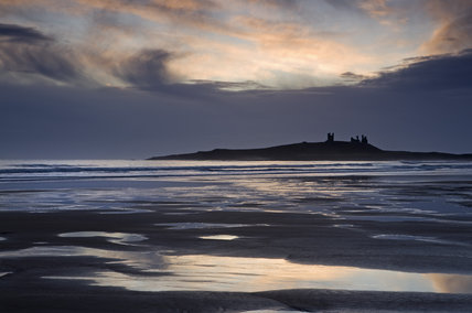 Embleton Bay, looking towards Dunstanburgh Castle at sunrise, Northumberland