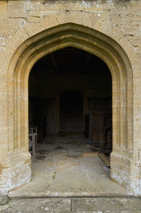 Arched stone entrance at Barrington Court, Somerset