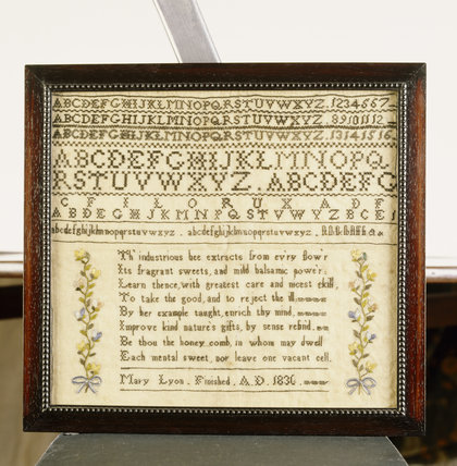 A sampler by Mary Lyon (1836) on the Upstairs Landing at Stoneacre with a design of alphabets, a poem and flower decoration
