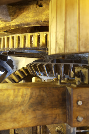 Close view of the wooden mill gearing at C18th Winchester City Mill, Hampshire