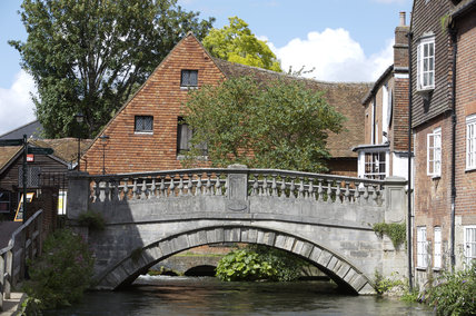 Winchester City Mill, Hampshire and bridge spanning the River Itchen
