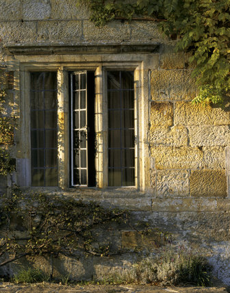Close-up detail of an open window on the South Front of Bateman's, the home of Rudyard Kipling