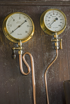Pressure gauges - part of the workings of the beam engines at Cornish Mines & Engines at Pool, near Redruth, Cornwall