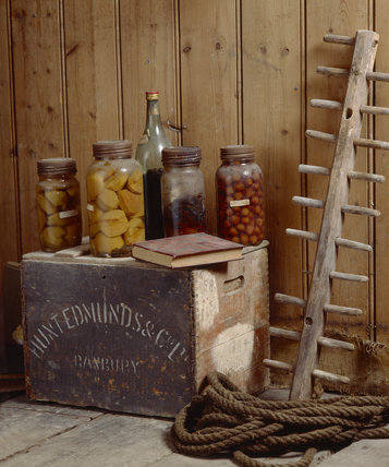 The corridor outside the Great Parlour with a close-up of a couple of dusty jars of fruit on a wooden box
