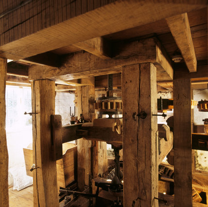 The ground floor of the Mill, showing how the rotation from the water wheel is turned through 90 degrees to turn the stones