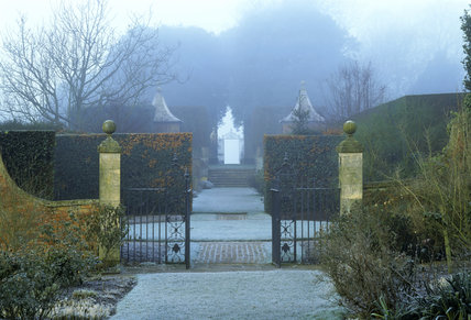 A view of the gates at Hidcote Manor Garden looking from the Old Garden