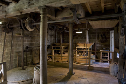 Restored workings inside Stainsby Mill, a working, water-powered flour mill on the  Hardwick Hall Estate, Derbyshire