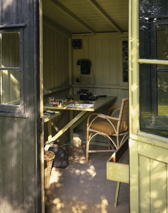 View of the interior of the Rotating Writing Shed in the garden at Shaw's Corner, showing the typewriter and various items of the dramatist George Bernard Shaw