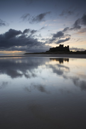 Huge skies and cloudscape reflected on the mirror-like surface of the damp sand at Bamburgh Castle (Not National Trust)