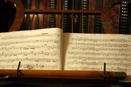 Close view of sheets of music on a stand in the room known as Nadir, at Snowshill Manor, Gloucestershire