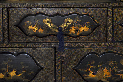 Close view of one of the drawers in a Japanese Buddhist shrine or Butsudan cabinet, part of the Charles Wade collection in the Green Room at Snowshill Manor