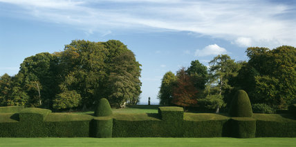 View towards the statue of Hercules by Van Nost (1720) in the Lime Avenue at Chirk Castle, showing the great yew hedge in the foreground