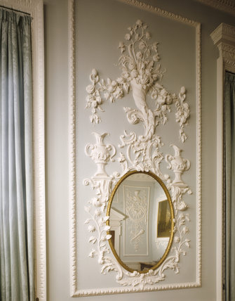 Oval pier glass set into a plasterwork frame, designed by William Perritt
