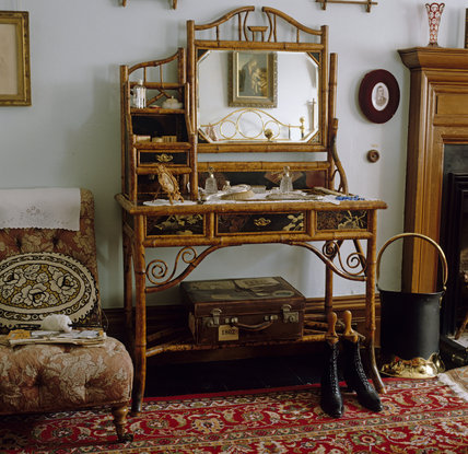 A bamboo dressing table in the Nannies Bedroom at Lanhydrock