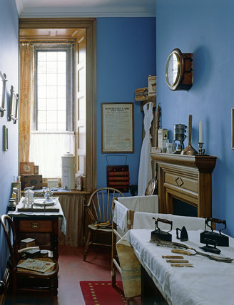 A room view of the Nursery Scullery showing the blue painted walls and a window at the rear of the room at Lanhydrock