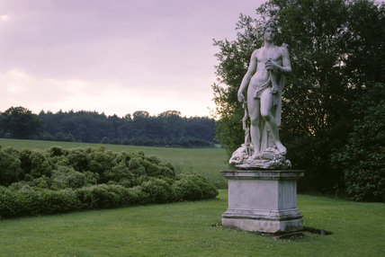 View of a statue on the lawn to the west of the house at Mottisfont Abbey, Hampshire