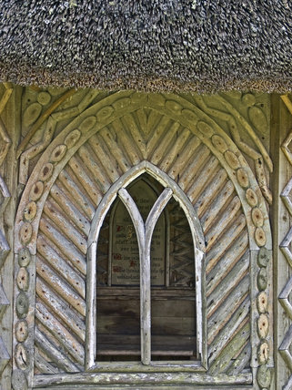 Close view of the arched window in the wooden gazebo in the garden at Finch Foundry