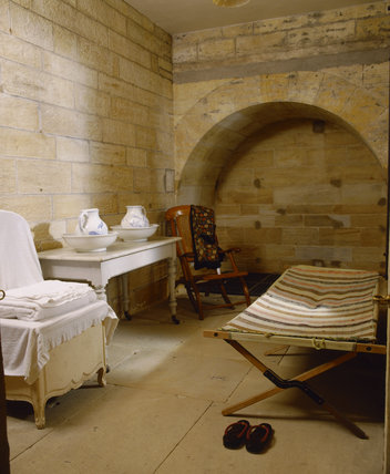 The Turkish Baths at Cragside, Northumberland showing the dressing area including the lounger and screens