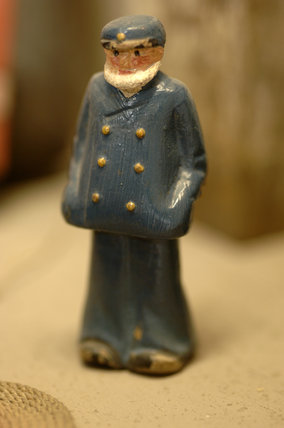 Close view of a wooden figure of a captain, part of the reconstruction of Wolf's Cove, the model village which was once in the garden at Snowshill Manor but is now in the room known as Occidens