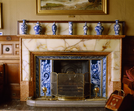 A close view of the Library fireplace made by Forsyth with onyx surround, at Cragside, Northumberland