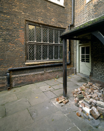 Looking North West across the courtyard at Sutton House towards the C16th Armada Window now in its 1700 location The porch to the right was added in 1904