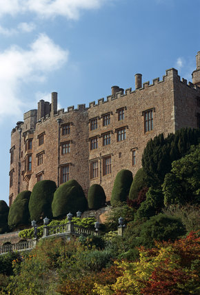 An exterior view of Powis Castle with the stunning Baroque terraces of the garden below