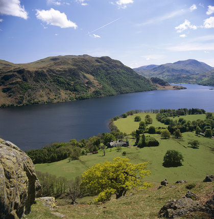 A view down the length of Ullswater from Gowbarrow Fell, with rugged mountains on the far shore