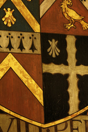 Close view of the Wade family coat of arms in the Entrance Hall at Snowshill Manor, Gloucestershire