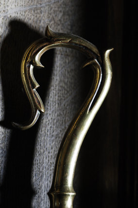 The sheep crook of a brass staff found in the Lobyy at Snowshill Manor, home of collector Charles Wade