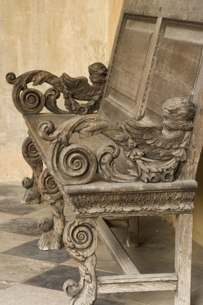 Elaborately carved wooden bench by Henry Harlow in 1674 at the North front of Ham House, Surrey