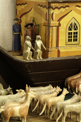 Close view of the wooden Noah's Ark with model animals made in the mid-C19th in the Black Forest area of Germany, collected by Charles Wade and displayed with other toys in Seventh Heaven, Snowshill Manor