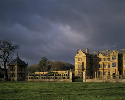 Across the park to the East Front of Montacute with stormy sky behind
