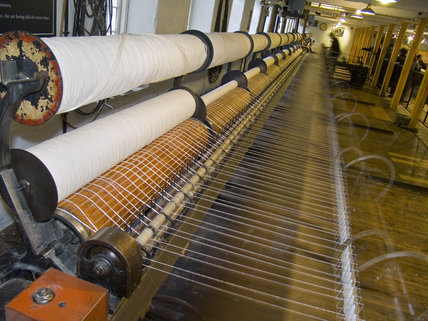 A full-length Spinning Mule at Quarry Bank Mill, Styal, invented by Samuel Crompton and patented by him in 1779, combining the drawing out process of the Water Frame with the moveable carriage of the Spinning Jenny