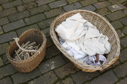 A washing basket and basket of pegs in the Courtyard of Court 15, Birmingham Back to Backs