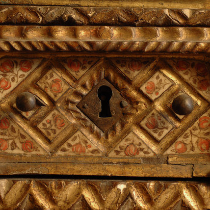 Close view of the detail on a Spanish Vargueno cabinet in the Grey Room at Snowshill Manor, home of collector Charles Wade