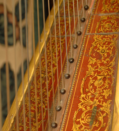 Close view of part of the mid-C19th harp made by Delveau in the Grey Room at Snowshill Manor