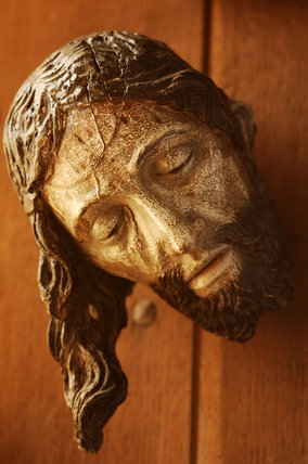 Close view of a wooden head of Christ crucified, in the room called Dragon at Snowshill Manor, part of the extensive collections of Charles Wade