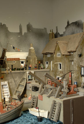 Close view of the harbour and harbour master's house, part of the reconstruction of Wolf's Cove, the model village which was once in the garden at Snowshill Manor but is now in the room known as Occidens