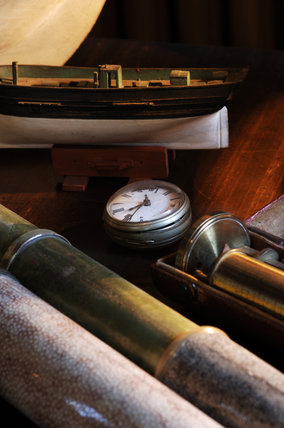 Collection of telescopes along with a pocket watch and part of a model boat in Admiral at Snowshill Manor