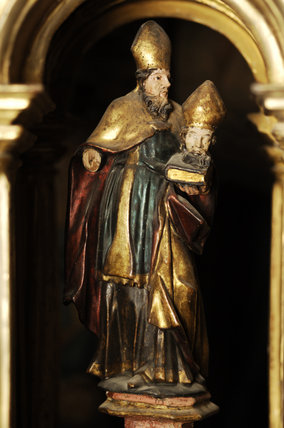 A carved figure of St Firmin, in golden gesso, in Meridian at Snowshill Manor, Gloucestershire, home of Charles Paget Wade