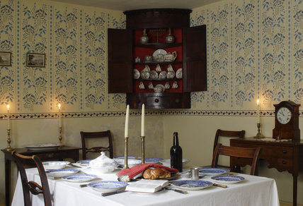 The front parlour of the 1840s house at the Birmingham Back to Backs, with the table laid