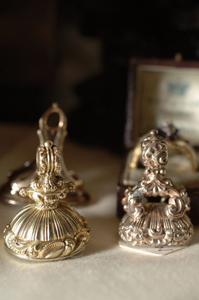Close view of silver seals, part of the Charles Wade Collection in Occidens at Snowshill Manor