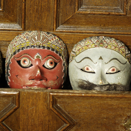 Two Topeng theatre masks from Java, part of the Chales Wade collection at Snowshill Manor, Gloucestershire